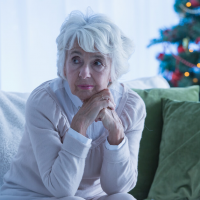lonely grieving woman during the holidays